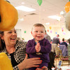 Nine-month-old Amelia Keenan, of Salem smiles after she sees Pluto and the Cat in the Hat at the Green Eggs and Ham Breakfast held by the Kiwanis Club at the Italian Community Center in Beverly on Saturday morning. DAVID LE/Staff photo 3/29/14