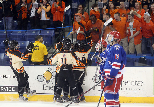 Beverly celebrates senior captain Matt Hamor's second period goal against the boards near the Beverly fan section as two dejected Tewksbury players skate past during the D2 North Final at the Tsongas Center at UMass Lowell on Monday evening. Beverly dominated Tewksbury 9-1 to advance to the D2 State Final to be played next Sunday at the TD Garden where the Panthers will take on South Division Champion Medfield. DAVID LE/Staff photo 3/10/14