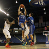 Danvers junior forward Devan Harris (25) grabs a rebound over a few New Mission defenders during the second half of play in the D2 North Final at the Tsongas Arena on Saturday afternoon. DAVID LE/Staff photo 3/8/14