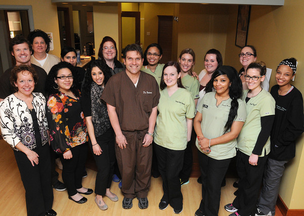 Ken Yuszkus/Staff photo: Peabody:  Varinos Dental staff are, front row from left,  Sharon Coleman, Wendy Lopez, Jessica Short, Frank Varinos, Kristen Henson, Maritza Garcia, Kim Consoli, and Raquel Espinosa, back row from left, Brandon Beaudoin, Julie Burdett, Stephanie Fernandes, Renee McKain, Jerica Frias, Monique DesFosses, Samantha Pagliarulo, and Amy Surette.