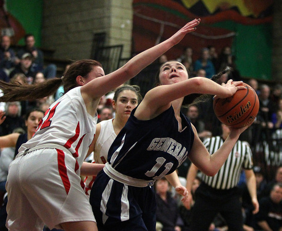 Hamilton-Wenham guard Molly Eagar (11) looks to make a shot while being defended by Watertown's Katelyn Rourke (31). DAVID LE/Staff photo 3/6/14