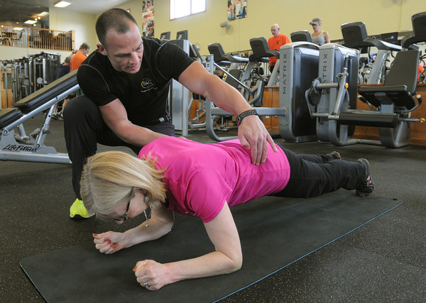 Ken Yuszkus/Staff photo: Fitness director Jason Mason works with Deborah Walker of Beverly at the Beverly Athletic Club.
