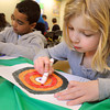 Ken Yuszkus/Staff photo: Salem:  Jason Rowen and Ava Sobezenski color their targets during Library Explorers, which is an independent story and craft time for grades K-4 at the Salem Public Library. They colored the targets for use with their miniature bow and arrows that related to the book, Robin Hood and Little John, which was read during the activity.
