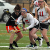 Marblehead sophomore defense Kylie Cronin (6) wins a ground ball against Woburn during the first half of play on Friday afternoon. DAVID LE/Staff photo 3/28/14