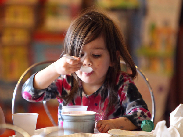 Clarissa Stiles, 3, of Danvers, happily eats her ice cream sundae during an Ice Cream Social Fundraiser to benefit the Colleen Ritzer Memorial Fund held at Putnam Pantry Candies in Danvers on Saturday afternoon. DAVID LE/Staff photo 3/29/14