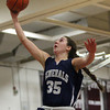Hamilton-Wenham senior captain Sam Charette (35) soars high in the air on her way to the basket against Watertown in the D2 North semifinal on Thursday evening. DAVID LE/Staff photo 3/6/14