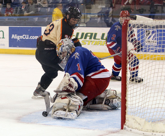 Beverly senior forward JJ Bachini (23) can't manage to poke the puck under the pads on Tewksbury junior goalie Kyle Paquette (1) during the D2 North Final at the Tsongas Center at UMass Lowell on Monday evening. Beverly dominated Tewksbury 9-1 to advance to the D2 State Final to be played next Sunday at the TD Garden where the Panthers will take on South Division Champion Medfield. DAVID LE/Staff photo 3/10/14
