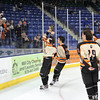 Beverly senior captain Connor Irving (22) brings the D2 North Championship trophy over to boards where cheering Beverly fans waited. Irving scored four goals and added an assist as the Panthers dominated the Redmen 9-1 to advance to the D2 State Final to be played next Sunday at the TD Garden where the Panthers will take on South Division Champion Medfield. DAVID LE/Staff photo 3/10/14