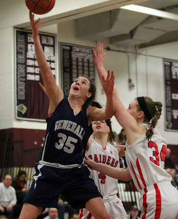 Hamilton-Wenham senior captain Sam Charette (35) drives hard to the hoop and lays the ball in off the glass around Watertown defender Fran Korte (34) during the fourth quarter of play on Thursday evening. DAVID LE/Staff photo 3/6/14