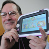 Ken Yuszkus/Staff photo: Beverly:   Tom Dusenberry speaks about games. He is holding a Leap Pad Ultra.