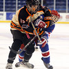 Beverly junior forward Jesse MacLaughlin (15) battles for position with Tewksbury junior defenseman Robert Cutone (6) during the D2 North Final at the Tsongas Center at UMass Lowell on Monday evening. Beverly dominated Tewksbury 9-1 to advance to the D2 State Final to be played next Sunday at the TD Garden where the Panthers will take on South Division Champion Medfield. DAVID LE/Staff photo 3/10/14