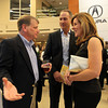 Marblehead residents Jerry Tucker, left, and Michael and Judy Bouchard, chat during the 5th annual Gourmet Gala hosted at Acura of Peabody by the North Shore Medical Center to help raise money for the annual North Shore Cancer Walk/Run. DAVID LE/Staff photo