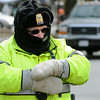 Ken Yuszkus/Staff photo: Salem:  Salem Police Sergeant Kathleen Makros battles the cold as she works a detail on Hawthorne Boulevard at the corner of Charter Street in Salem.