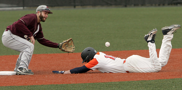 Ken Yuszkus/Staff photo: Salem:   Salem State University's Ryan Beliveau slides safely onto 2nd base as Rhode Island College's Dean Beshansky is about to miss the throw.