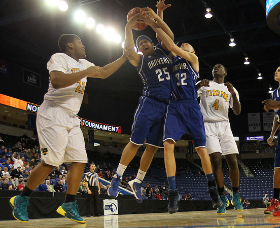Danvers juniors Devan Harris (25) and Peter Merry (32) battle for a rebound against New Mission during the second half of play in the D2 North Final at the Tsongas Arena on Saturday afternoon. DAVID LE/Staff photo 3/8/14