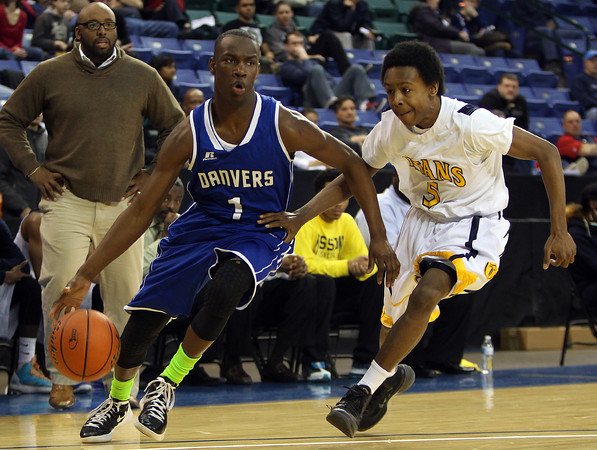 Danvers sophomore Rashad Francois (1) drives to the hoop past New Mission freshman Charles Mitchell (5) during the second quarter of play. The Falcons fell to New Mission 60-51 at the Tsongas Center at UMass Lowell in the D2 North Final, ending the Falcons 14-game postseason win streak. DAVID LE/Staff photo 3/8/14