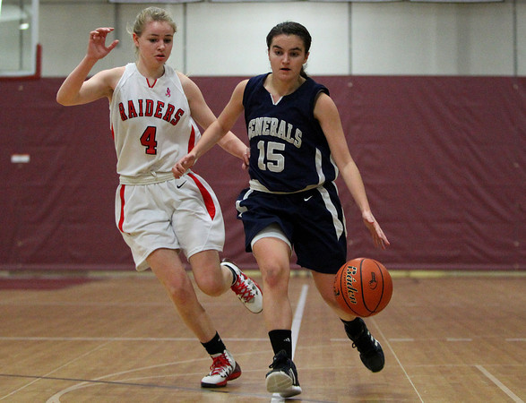 Hamilton-Wenham senior captain Sue Rose (15) advances the ball up court while being trailed closely by Watertown's Rachel Morris (4). DAVID LE/Staff photo 3/6/14