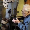 Ken Yuszkus/Staff photo: Hamilton:   Hamilton native and former Fire Chief Bob McRae is closing Mac's Shoe Repair after 64 years. He is using a nailing machine while working on the heel of a shoe.