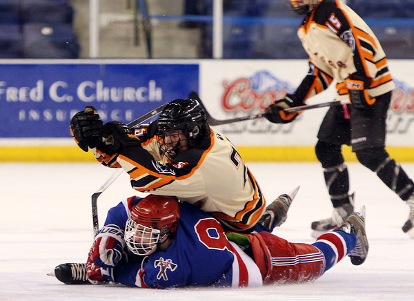 Beverly senior captain Sean Munzing (25) flattens Tewksbury junior forward Ryan Petti (8) during the D2 North Final at the Tsongas Center at UMass Lowell on Monday evening. Beverly dominated Tewksbury 9-1 to advance to the D2 State Final to be played next Sunday at the TD Garden where the Panthers will take on South Division Champion Medfield. DAVID LE/Staff photo 3/10/14