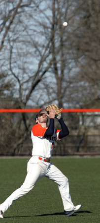 Ken Yuszkus/Staff photo: Salem: Salem State University's Ryan Beliveau grabs a deep fly ball for an out during the Brandeis at Salem State University baseball game.