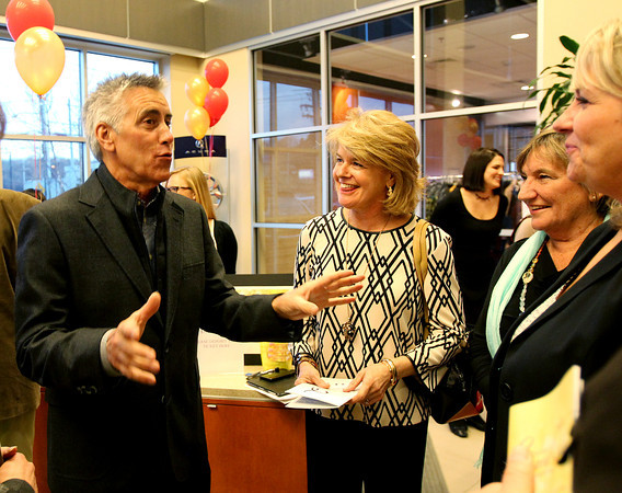 Local TV and radio personality Billy Costa, left, chats with Marblehead residents Mary Homan, Paula Dobrow, and Peggy Houghton, at the 5th annual Gourmet Gala hosted at Acura of Peabody by the North Shore Medical Center to help raise money for the annual North Shore Cancer Walk/Run. DAVID LE/Staff photo
