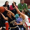 Hamilton-Wenham senior guard Sue Rose (15) looks to make a pass around Watertown's Gianna Copolla (14) on Thursday evening in the D2 North semifinal at Chelmsford High School. DAVID LE/Staff photo 3/6/14