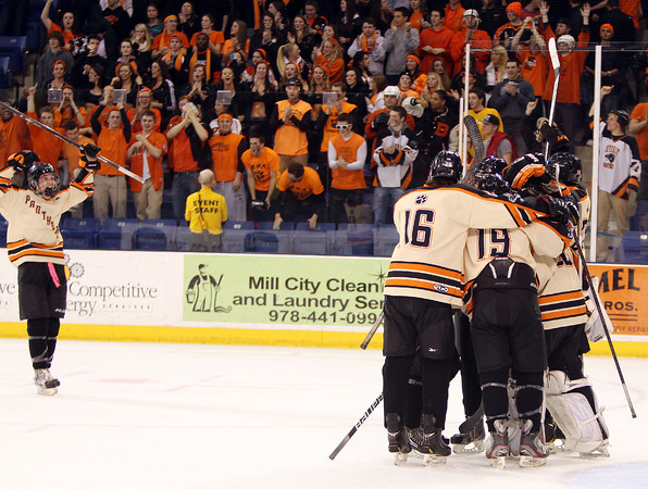 The Beverly Panthers storm to greet senior goalie Bryce Mitchell (after he took over for junior Tim Birarelli halfway through the third period) after the Panthers defeated Tewksbury 9-1 to capture the D2 North Championship at the Tsongas Center at UMass Lowell on Monday evening. Beverly dominated Tewksbury 9-1 to advance to the D2 State Final to be played next Sunday at the TD Garden where the Panthers will take on South Division Champion Medfield. DAVID LE/Staff photo 3/10/14