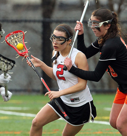 Marblehead senior Adrienne Ciccone (2) tries to get past a Woburn defender during the first half of play on a rainy Friday afternoon. DAVID LE/Staff photo 3/28/14