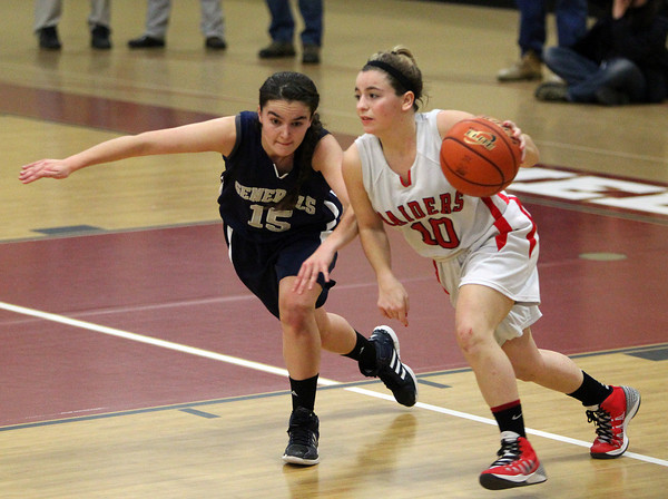 Hamilton-Wenham senior captain Sue Rose (15) tries to stick with Watertown guard Gabby Copolla (10) as she brings the ball up court during the third quarter of play on Thursday evening. DAVID LE/Staff photo 3/6/14