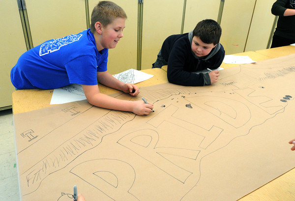 Ken Yuszkus/Staff photo: Danvers: Riverside School 5th grade students Evan Conti, left, and Eli Tamulonis design a mural in preparation of the Rail Trail Mural being painted later this year.