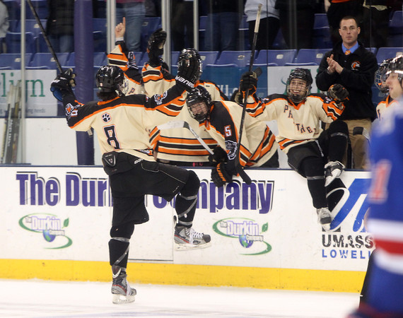 Beverly junior defenseman Nick Albano (8) celebrates his second period goal with his teammates on the bench during the D2 North Final at the Tsongas Center at UMass Lowell on Monday evening. DAVID LE/Staff photo 3/10/14