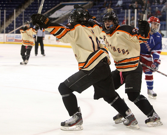 Beverly senior forward JJ Bachini (23) comes over to celebrate line mate Jake Straw's (14) goal during the first period of play during the D2 North Final at the Tsongas Center at UMass Lowell on Monday evening. DAVID LE/Staff photo 3/10/14
