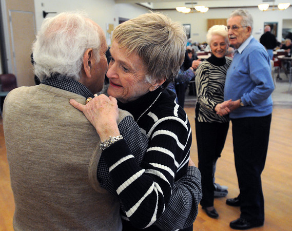 Ken Yuszkus/Staff photo:  Peabody: Eileen Dumouchel and Peter Chevoor, left, both of Peabody, dance to the music of the Golden Echoes Dance Band at the Peter A. Torigian Community Life Center in Peabody. Big band dancing happens every Thursday from 9:30 to 11:00 at the center.