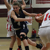 Hamilton-Wenham senior guard Haley Willis (4) drives into the lane against Watertown on Thursday evening. DAVID LE/Staff photo 3/6/14
