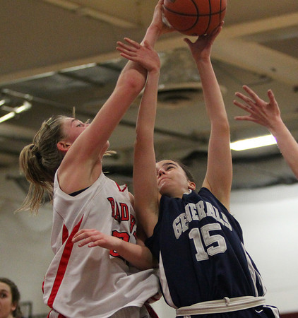 Hamilton-Wenham senior captain Sue Rose (15) gets her shot blocked by Watertown's Shannon Murphy (21) during the first half of play on Thursday evening. DAVID LE/Staff photo 3/6/14