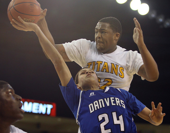 Danvers freshman Devon Allen (24) gets his layup blocked by New Mission senior Fred Rivers (22) during the second half of play. The Falcons fell to New Mission 60-51 at the Tsongas Center at UMass Lowell in the D2 North Final, ending the Falcons 14-game postseason win streak. DAVID LE/Staff photo 3/8/14