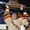 Beverly senior Graham Doherty hoists the D2 North Championship trophy high above his head and lets out a whoop of excitement after the Panthers downed Tewksbury 9-1 to capture their first ever D2 North Title. Beverly now advances to the D2 State Final to be played next Sunday at the TD Garden where the Panthers will take on South Division Champion Medfield. DAVID LE/Staff photo 3/10/14