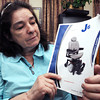 Ken Yuszkus/Staff photo: Salem:  Patricia Champagne recently had her motorized wheelchair stolen from outside her home in Salem. She is holding the mannual with a photo of the motorized wheelchair.