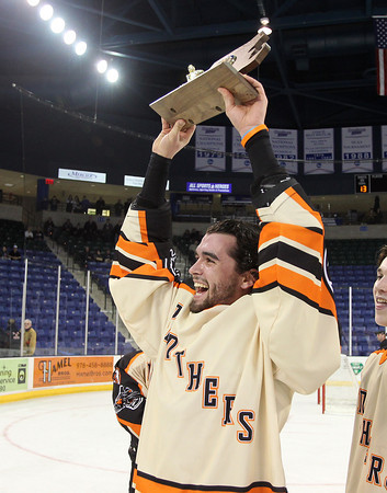 Beverly senior Jack Morency hoists the D2 North Championship trophy high above his head for all to see after the Panthers captured their first D2 North crown with a dominating victory over Tewksbury 9-1 to advance to the D2 State Final to be played next Sunday at the TD Garden where the Panthers will take on South Division Champion Medfield. DAVID LE/Staff photo 3/10/14