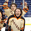 Beverly senior forward Kevin Lally (3) screams in excitement as junior teammate Jesse MacLaughlin raises his arms in celebration after Beverly captured the D2 North Championship with a dominating 9-1 win over Tewksbury at the Tsongas Center at UMass Lowell on Monday evening. Beverly dominated Tewksbury 9-1 to advance to the D2 State Final to be played next Sunday at the TD Garden where the Panthers will take on South Division Champion Medfield. DAVID LE/Staff photo 3/10/14