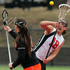 Marblehead senior midfielder Sydney Cayen (18) wins a face-off draw against Woburn on Friday afternoon. DAVID LE/Staff photo 3/28/14