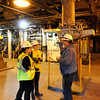 Ken Yuszkus/Staff photo: Salem:  Dave Burke talks with Katherine Roldan, left, and Kaitlyn Assmann, center, at the Salem Power Plant. Art students from Montserrat are undertaking a project to document the experiences of workers at the plant.