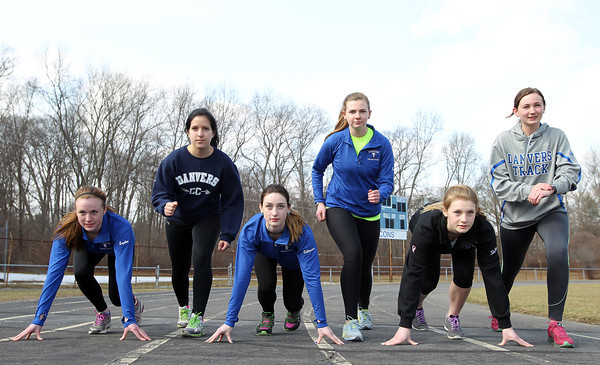 The Danvers outdoor girls track team will be led by from left: junior Sophie Cawlina (100/sprints), junior Catalina Dominick (2-mile/distance), junior Angela Caldarone (400/LJ/sprints), senior captain Ellen Tye (distance), sophomore Erin St. Pierre (hurdles/sprints), and senior captain Jessica Driscoll (mile/distance). DAVID LE/Staff photo