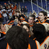 The Beverly Panthers display the D2 North Championship trophy high above their heads in front of cheering Beverly fans. Irving scored four goals and added an assist as the Panthers dominated the Redmen 9-1 to advance to the D2 State Final to be played next Sunday at the TD Garden where the Panthers will take on South Division Champion Medfield. DAVID LE/Staff photo 3/10/14
