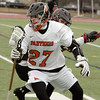 Ken Yuszkus/Staff photo:  Beverly:  Beverly's captain Matt Page turns hard to protect the ball during the Winchester at Beverly boys lacrosse game which was the season opening game.