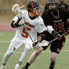 Ken Yuszkus/Staff photo:  Beverly:  Beverly's Sam Abate has control on the ball with a Winchester player closing in during the Winchester at Beverly boys lacrosse game which was the season opening game.