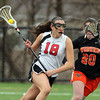 Marblehead senior midfielder Sydney Cayen drives to the net against Woburn on Friday afternoon. DAVID LE/Staff photo 3/28/14