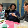 Ken Yuszkus/Staff photo: Swampscott:  From left, Judy McKenzie, retired 7th grade teacher who started the Pen Pal program with the sister school in South Africa, Principal Sheila Galo from South Africa, and Mary Casey, 7th grade teacher, have lunch at the Swampscott Middle School teacher's room.