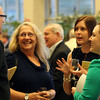 North Shore Medical Center Davenport 9 employees Debi Doucette, Megan Corbett, and Jonelle O'Connor, chat with Carl Frithsen, of Mass General at the 5th annual Gourmet Gala hosted at Acura of Peabody by the North Shore Medical Center to help raise money for the annual North Shore Cancer Walk/Run. DAVID LE/Staff photo
