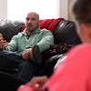 Danvers resident Mike Chase talks about his story on the day of the Boston Marathon bombing as his wife Dena listens on. Mike Chase and close friend Dan Marshall were both at the bombing site and amidst the chaos helped try and save Martin Richard and his sister. DAVID LE/Staff photo 3/6/14